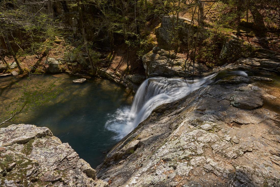 Dappled Sunlight On A Waterfall